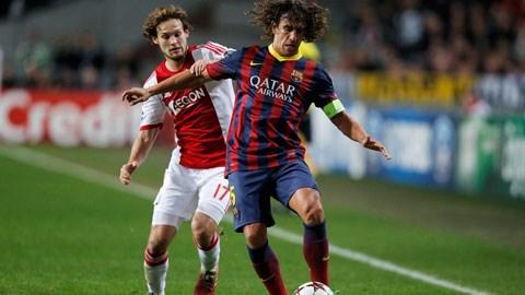Blind (trái) là ưu tiên hàng đầu của Barca trong nỗ lực lấp vào lỗ hổng mà Carles Puyol để lại