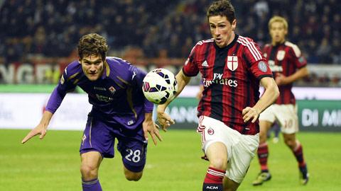 Atletico cần một chân sút đẳng cấp chứ không phải hết thời như Torres (phải)