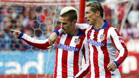 Griezman (trái) lập cú đúp đem về thắng lợi cho Atletico