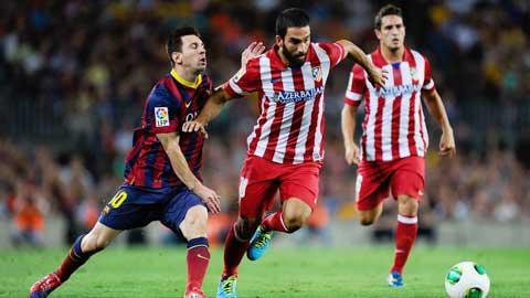 Turan (phải) muốn trở thành đồng đội của Messi tại Barca