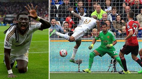 Gomis (trái) ghi bàn ấn định thắng lợi 2-1 cho Swansea