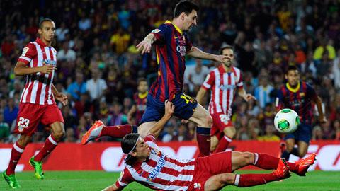 Một pha tranh chấp giữa 2 cầu thủ Nam Mỹ Filipe Luis và Lionel Messi
